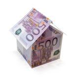 Дом сделанный банкнот на изолированной белой предпосылке Стоковое фото RF