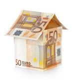 Дом сделанный из денег на белизне Стоковая Фотография RF