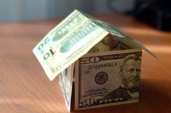 Дом сделанный из денег Стоковые Фотографии RF