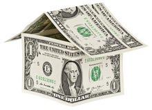 Дом сделан американского изолированного доллара на белом backgroun Стоковые Изображения RF
