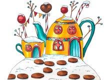 Дом чашки и чайника зимы с ягодами и конфетами стоковые фотографии rf