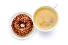 Донут и кофе изолированные на белизне Стоковое фото RF
