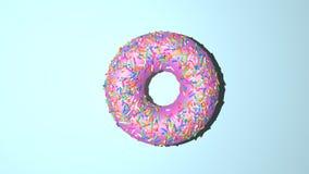 Донут представляет взгляд сверху Донут с розовыми creme и радугой брызгает на верхней части стоковое изображение