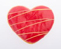 Донут, сердце сформировал печенье на предпосылке стоковое изображение