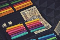 Дорогая тема школы, случай карандаша с польскими деньгами Стоковые Изображения