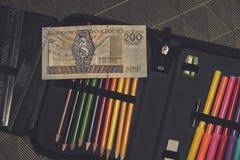Дорогая тема школы, случай карандаша с польскими деньгами Стоковые Изображения RF