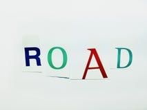 Дорога - вырез формулирует коллаж смешанных писем кассеты с белой предпосылкой Стоковое Фото