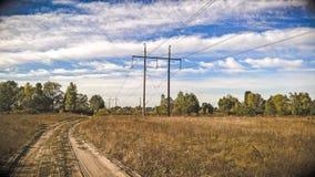 Дорога в поле Стоковые Изображения