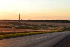 Дорога в лучах спада стоковая фотография rf