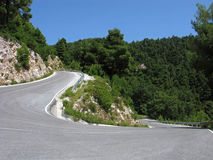 Дорога горы с острым поворотом стоковое фото