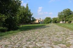 Дорога деревни булыжника Стоковое фото RF