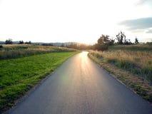 Дорога загоренная солнцем Стоковое Изображение