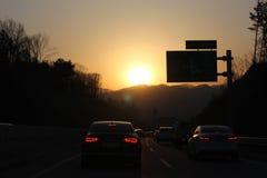 Дорога захода солнца вечера, красивое фото Стоковые Изображения RF