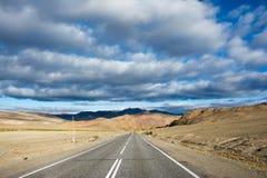 Дорога и облака Стоковое фото RF