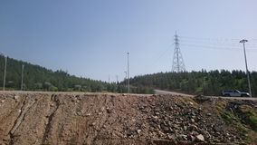 Дорога на горах принятых на мое отключение Стоковые Фото