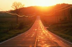 Дорога на заходе солнца Стоковое Изображение RF
