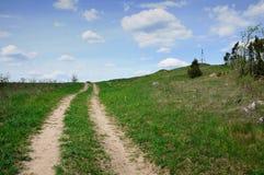 Дорога поля в холмистом районе Стоковая Фотография RF