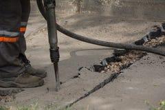 Дорога ремонтируя работы с jackhammer Стоковая Фотография RF