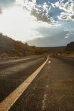 Дорога rt захода солнца Стоковое Изображение RF