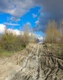 Дорога Sandy против неба Стоковое Фото