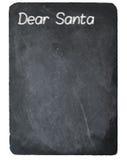 Дорогое письмо Санты используя мел на классн классном шифера Стоковое Изображение RF