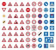 Дорожные знаки движения установленные на белизну Стоковые Изображения