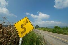 Дорожные знаки около дороги Стоковые Фото