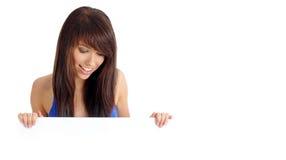 доска держа сексуальную женщину стоковое изображение