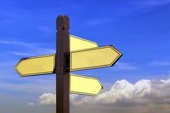 Доска знака направления под голубым небом Стоковое Изображение