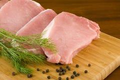 доска прерывает свинину укропа вырезывания свежий Стоковые Изображения RF