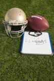 Доска сзажимом для бумаги шарика шлема футбола и портрет свистка Стоковая Фотография