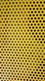 Доска утюга текстуры предпосылки желтая с круглыми отрезками до конца стоковое изображение