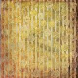Достигшая возраста золотая желтая коричневая striped предпосылка донута стоковое изображение