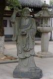 Досточтимая каменная высекать-большая статуя 18 Стоковое фото RF