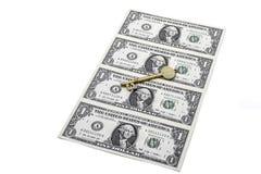 Долларовая банкнота и ключ Стоковые Изображения