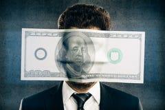 Долларовая банкнота на бизнесмене стороны Стоковая Фотография