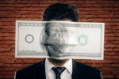 Долларовая банкнота на бизнесмене стороны Стоковое фото RF
