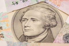 Долларовая банкнота 10 окруженная китайскими юанями Стоковая Фотография RF