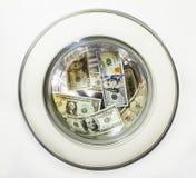 Долларовые банкноты в барабанчике стиральной машины Стоковые Изображения