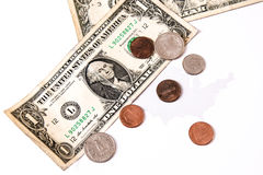 Долларовые банкноты и центы над картой Соединенных Штатов Стоковые Фото