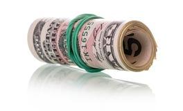 Долларовые банкноты свернутые вверх Стоковое Фото