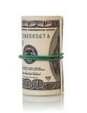 Долларовые банкноты свернутые вверх Стоковые Изображения