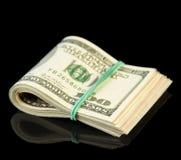 Долларовые банкноты свернутые вверх Стоковое фото RF