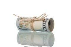 Долларовые банкноты свернутые вверх Стоковые Фото