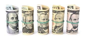 Долларовые банкноты свернули вверх и связанный с веревочкой изолированный на белом b Стоковое фото RF
