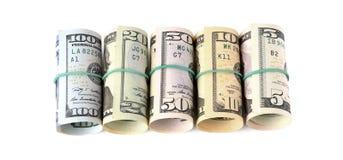 Долларовые банкноты свернули вверх и связанный с веревочкой изолированный на белом b Стоковая Фотография RF