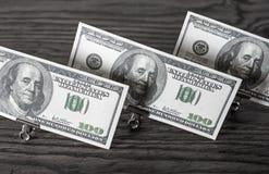 Доллары в бумажных зажимах Стоковое Изображение