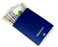 Доллары в пасспорте Стоковое Изображение RF