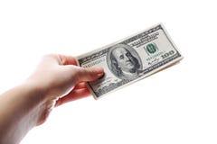 Доллары в руке на белизне Стоковые Изображения RF