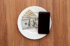 Доллары деноминации и черный телефон дела Стоковое Изображение